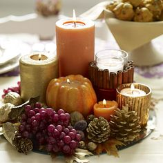 Thanksgiving Centerpiece ~ Create a large dramatic centerpiece just by grouping several similar themed or colored items together on a serving platter.