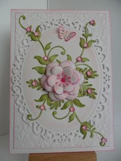 Catty Creations  White linen and green textured card Cuttlebug 5 x 7 embossing folder, inked with Spun Sugar Spellbinders Floral Ovals Marianne D Flowers XL dies Memory Box Cherry Blossoms die Die-namics Leafy Flourish die PunchBunch Fern large Martha Stewart PATP Butterflies (corner)  Fiskars hand punch flower