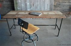 reclaimed plank wood desk with old plumbing pipes for leg framing
