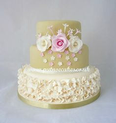 Coffee and cream with pale pink, frills and sugar flowers 3 tier wedding cake