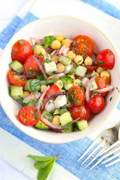 A bright Mediterranean chickpea salad with cucumbers, feta, cherry tomatoes, herbs and lemony dressing, a quick easy side salad that goes with everything. Mediterranean Chickpea Salad, Mediterranean Recipes, Salad Recipes, Healthy Recipes, Chickpea Recipes, Veggie Recipes, Delicious Recipes, Vegetarian Main Dishes, Spring Recipes