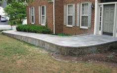outside entrance wheelchair ramp,. This would be ok if you had shrubs or flowers to hide the thing.