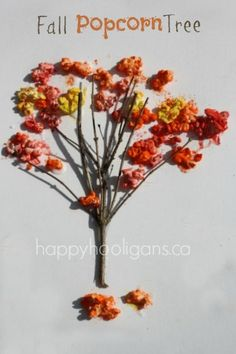 """Fall Popcorn Tree: A super fall tree craft for preschoolers. Great way to learn about the colours of fall. The hooligans LOVE the """"shakey-shakey"""" process we use to colour the popcorn. Great fine-motor craft too! happy hooligans"""