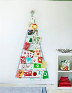 Here's a no-fuss way to display all the holiday cards that arrive in your mailbox each day. And don't worry: Washi tape pulls right off the wall without damaging the paint. What to do Use a pencil and yardstick to mark the three points of a large triangle (ours measures 5 x 3¼ feet). Apply ¾-inch-wide washi tape, as desired, to create the tree outline, and add a trunk that's centered at the bottom. Use removable mounting squares to hang the cards and a sparkly pom-pom on top.