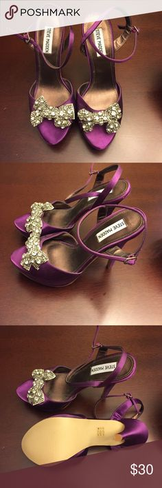 Steve Madden Luvly in purple Never worn! Size 8 peep toe Steve Madden heels. They have a bit of a platform and large rhinestone bow! Steve Madden Shoes Heels