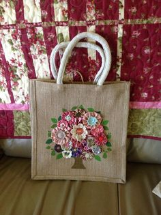 Hessian recycle grocery bag decorated with yo-yo flowers.: