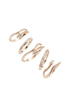 Sinuous lines and sparkling crystals charm the slender bands in this playful and elegant set of rose gold rings that can be mixed and remixed to create a signature look.