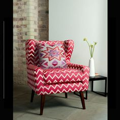 Clarke and Clarke - South Beach Fabric Collection - Large zigzag print chair in red and white, with a multicoloured Aztec print cushion, black side table and an elegant white vase South Beach, Bamboo Blinds, Wood Blinds, Blinds Curtains, Furniture Showroom, Home Furniture, Furniture Ideas, Vertical Window Blinds, Shutter Blinds