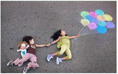 girls w/chalk balloons on driveway