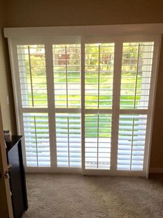 Plantation Shutters On Bypass Tracks In Front Of Sliding Glass Doors
