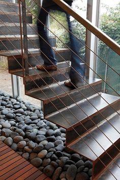 River rocks shadow staircase. Erla Dögg Ingjaldsdóttir.
