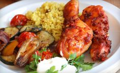 Groupon - West African Cuisine at Dinner at Roger Miller Restaurant (Half Off). Two Options Available.. Groupon deal price: $12.00
