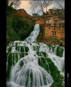 The medieval village separated by a waterfall / Orbaneja del Castillo, el pueblo medieval separado por una cascada. by OMA photo, via Flickr