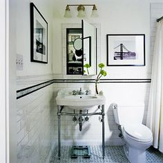Black and white bath with stripe detail.
