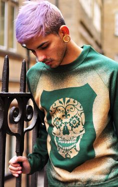 Light purple hair. Skull sweater. Gauged ears.