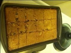 This recipe comes courtesy of a 86 year old lady that has been cooking since she was 9 years old. The recipe has been in her family for many years. The ground pecans gives it a texture of cornbread, but there isnt any cornmeal in it. This cake is perfect for potlucks or to pack in lunchboxes.