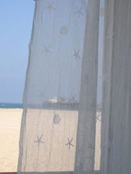 "Coastal curtains white shell panel large 45x84"" Lace curtain panel with shells & starfish by homebytheseashore.com $64"