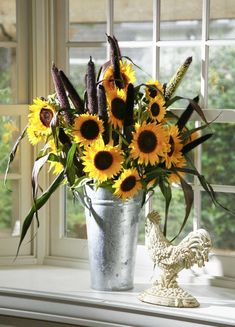 Three ways to decorate with sunflowers sunflower arrangements can go country or contemporary. 'Purple Majesty' millet and Texas sunflowers in a French flower bucket create an informal arrangement for a kitchen garden window. Sunflower Centerpieces, Sunflower Arrangements, Beautiful Flower Arrangements, Floral Arrangements, Western Centerpieces, French Flowers, Fall Flowers, Flowers Bucket, Flowers Garden