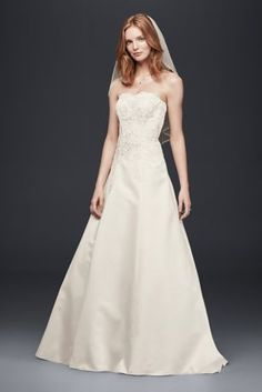 ThisA-line wedding dress is the very picture of classic beauty. The…