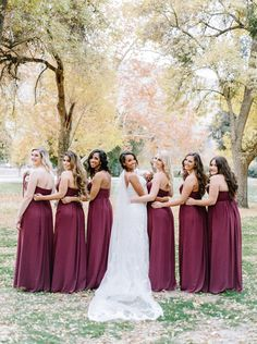 Burgundy bridesmaid dresses + Bride in lace wedding dress | fabmood.com #fallwedding #weddingdress #burgundy #wedding