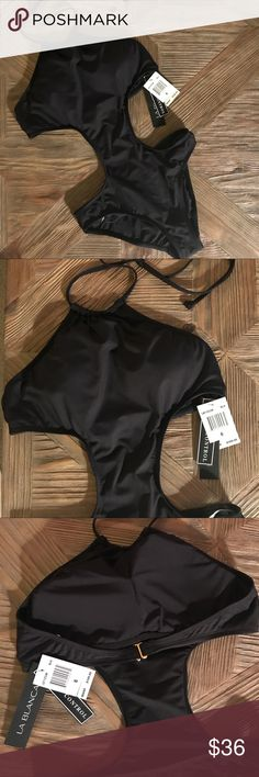 NWT LA BLANCA Black High Neck Monokini Swimsuit NWT LA BLANCA Black High Neck Cut Out Monokini Swimsuit. Monokini is a hybrid of a one piece and bikini, gives you enough tummy coverage while still able to show off like a bikini. Swimsuit built with tummy control. Built-in bra cups for added coverage and support. New and never been worn! La Blanca Swim