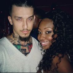Sexy interracial couple. No disrespect,but ya man is fine!!!! MmmmHmm Lol
