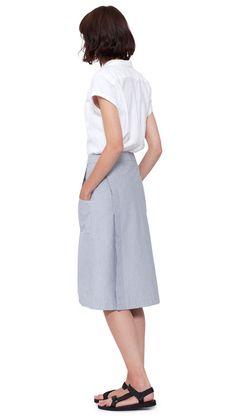 WOMEN SPRING SUMMER 2016 - White cotton airtex short sleeve shawl collar shirt, white/blue hairline stripe cotton apron skirt, black nylon Teva sandal. All items MHL