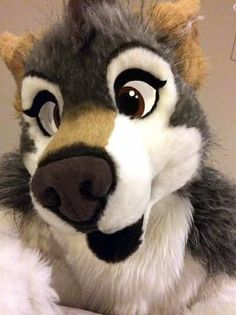 Love this fursuit! It is based off a character named Tes, who is a female wolf.   Fursuit and Tes the wolf created by deviantART user: tsebresos. Check her out sometime!