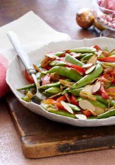 Sugar Snap Pea Saute — Colorful, crisp and on the table in just 20 minutes, this better-for-you Asian-inspired side will get snapped up in no time.