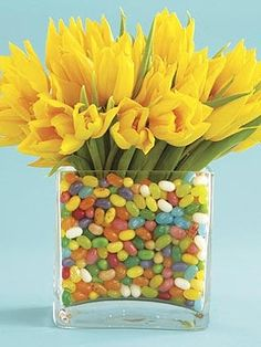 EDIBLE ARRANGEMENT Team bright flowers with bright candy in a clear vase — the sweets will hold the blooms in place while adding bonus color.