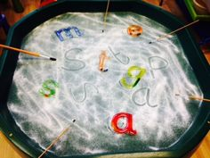 Mark making in the salt. We have been practising our letter formation using our paintbrushes to make letters in the magic dust. Engaging writing in EYFS