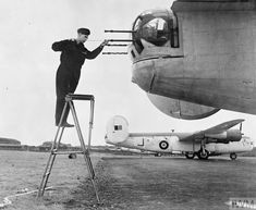 No 120 Squadron Liberator III's undergoing daily inspections at Aldergrove, April 1943. Here, an armourer cleans out the gun barrels of the rear turret. Lancaster Bomber, Ww2 Aircraft, Nose Art, Royal Air Force, World War Ii, Aviation, Coastal, History, Machine Guns