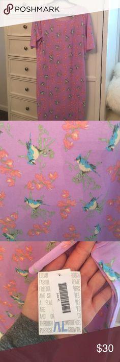 Lularoe Julia dress XL NWT lularoe Julia dress. Lavender/lilac purple with blue birds and pink flowers LuLaRoe Dresses Midi