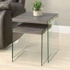 Features: -Made with reclaimed wood and tempered glass. -Dark taupe finish. -Requires assembly. Shape: -Square. Design: -Nesting tables. Style: -Contemporary. Top Finish: -Dark taupe. Base Fin