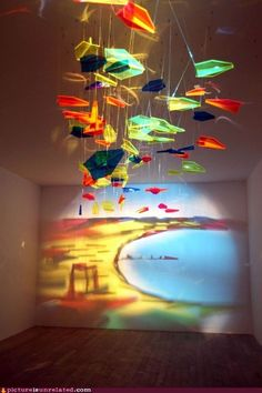 paper planes mobile. amazing colour and light project