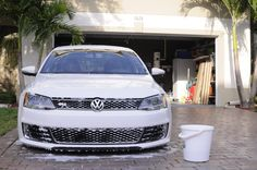 Volkswagen Jetta GLi lowered, pure white. Front grille/view during hand washing session.