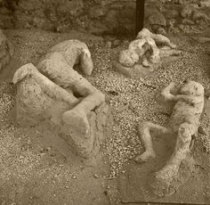 Casts of bodies buried in ash from the eruption of Mount Vesuvius in the ancient Roman city of Pompeii Ancient Ruins, Ancient Rome, Ancient History, Pompeii Italy, Pompeii And Herculaneum, Pompeii Ruins, The Places Youll Go, Places To See, Places Ive Been