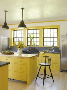 Kitchen: Love the bright yellow combined with soapstone and un-laquered brass fittings on the sink. Litchfield magazine - March/April 2013 - decorator Heidi Hendricks