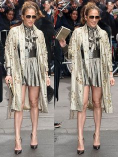 Jennifer Lopez in a silver Saint Laurent lamé blouse and skirt, Jenny Packham spring 2015 metallic coat, and Jimmy Choo 'Anouk' pumps in Smoke Watersnake.