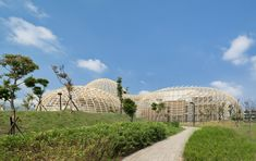 Dome-shaped structures enclose the Taoyuan Sewage Treatment Project in Taiwan, designed by Habitech Architects to resemble mountains, with a waterfall Sewage Treatment, Micro Apartment, Little Designs, Plant Design, Cool Landscapes, Architect Design, Best Location, Amazing Architecture, Taiwan