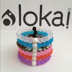 $25 for 6 Lokai Bracelets All Colors Select Size This listing is for 6 Lokai Bracelets One of each of the following colors Clear, Blue, Wildlife, Pink, Red and Purple. Each Lokai is infused with elements from the highest and lowest points on Earth. The Bracelet's White Bead carries Water from Mt. Everest, and its Black Bead contains Mud from the Dead Sea. Package will come with your choice of size for all 6 Lokai Bracelets. Lokai Jewelry Bracelets