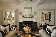 A striking Art Deco style living room in the key shades of black and white with gold accents to break up the monochrome look. Cream Living Rooms, French Living Rooms, Living Spaces, Home Design, Design Blog, Art Deco Living Room, Living Room Designs, Room Art, Black And Gold Living Room