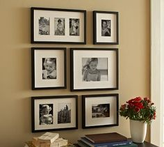 Gallery wall in play space with family pictures