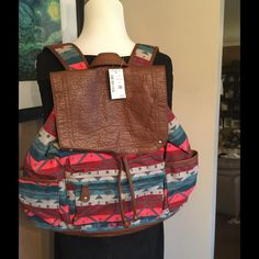 Make Offer 💥 Last One ! Aeropostale Backpack ! ❤️ Aeropostale Aztec designed backpack ! 2 side pockets ! Zip front compartment ! Magnetic snap closure ! Vegan leather on flap bottom and drawstrings ! It is a dark grey inside ! The colors are turquoise reds and browns ! A beauty ! ❤️ Aeropostale Bags Backpacks
