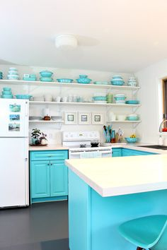 DIY Painted Vinyl Floor // DIY Kitchen Makeover on a Budget // Turquoise Kitchen Cabinets Turquoise Kitchen Cabinets, Teal Kitchen, Eclectic Kitchen, Kitchen Floors, Diy Kitchen, Kitchen Ideas, Painted Bathroom Floors, Painted Vinyl Floors, Paint Bathroom