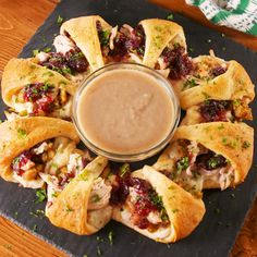 Thanksgiving leftovers aren't regular leftovers, they're *cool* leftovers. Stuffed inside a crescent roll (basically a giant crescent roll), they're EVERYTHING. Get the recipe at Delish.com. #delish #easy #recipe #thanksgiving #leftovers #turkey #cranberry #pillsbury #crescent #crescentroll #sandwich #ideas #whattodo #thanksgivingleftovers Stuffing Leftover Recipes, Easy Leftover Turkey Recipes, Turkey Stuffing Recipes Thanksgiving, Thanksgiving Videos, Thanksgiving Leftover Casserole, Cranberry Recipes Thanksgiving, Thanksgiving Lunch, Leftovers Recipes, Thanksgiving Appetizers