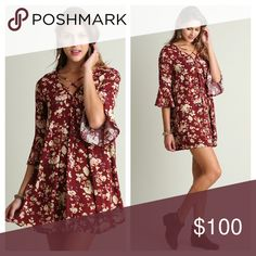 """Flirt With Me Floral Dress Flirt With Me Wine and Floral Dress! Features Criss Cross Detailing on Chest, Quarter Length Ruffle Sleeves, and a Shift Swing Fit. Available on www.shopbelovedboutique.com as well💋  Material: 65% Cotton 35% Polyester  Model is 5""""11 Wearing the Small.  Measurements: Small: B-34"""" L-34"""" Medium: B-36"""" L-34.5 Large: B-38"""" L-35"""" Dresses Mini"""