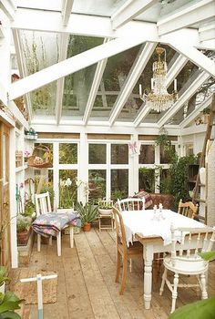 conservatory  I looooove this room. plants, photos, piano.