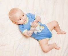 Picture of Small cute baby lying on her back stock photo, images and stock photography. Small Cute Babies, Little Learners, Children, Kids, Onesies, Infant, Baby, Young Children, Young Children