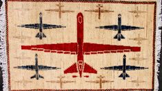 Art imitates life as carpet-makers weave images of war into their creations.